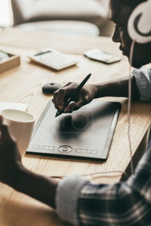 man drawing with digital tablet
