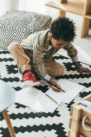 african american child drawing on floor