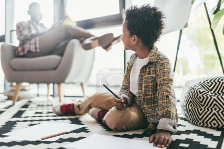 Child drawing in office