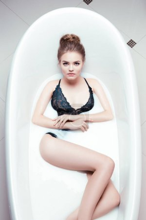 Woman relaxing in bath tube