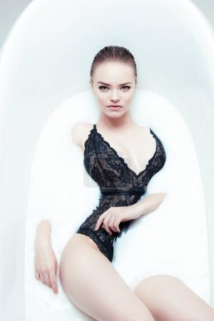 woman relaxing in bath tube