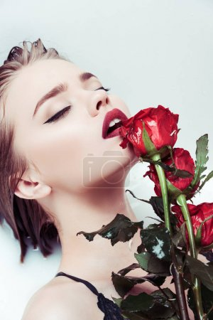 woman with red roses