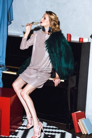 Young woman sitting on piano