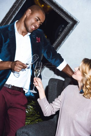 Young couple clinking glasses