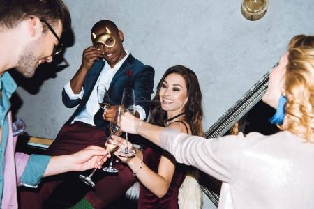 Photo for Group of friends on party with champagne glasses - Royalty Free Image