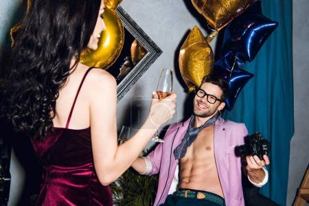 Young woman and man on party