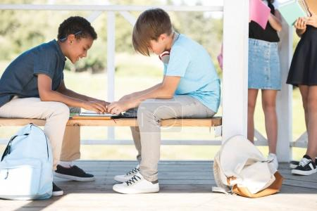 multiethnic boys studying together