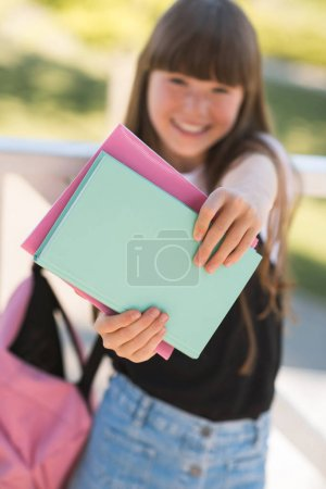 teenager holding books