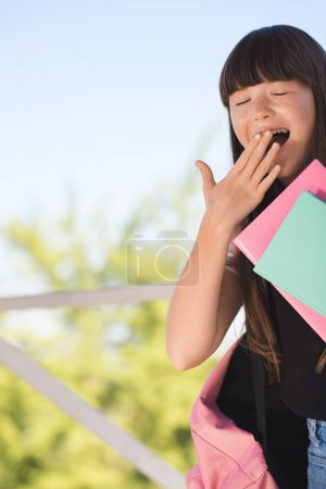 Yawning schoolgirl