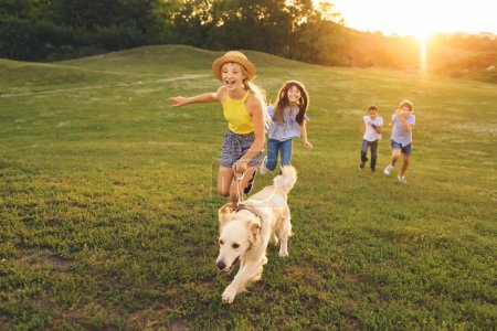 teenagers with dog walking in park