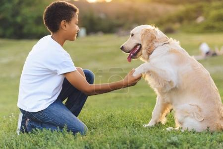 african american teenager with dog