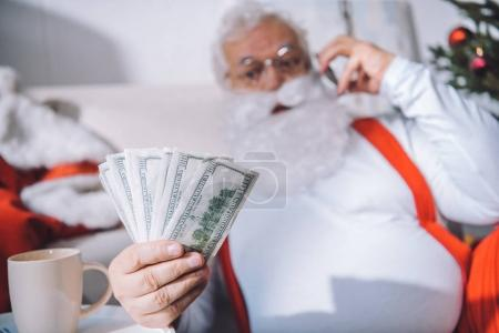 santa claus with cash in hand
