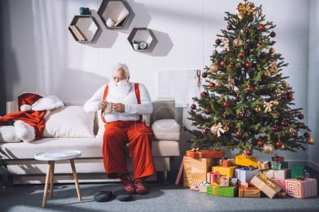 Santa claus with cup of coffee