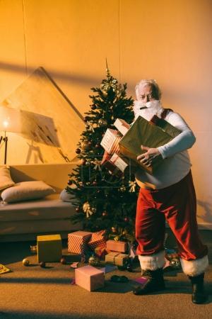 bad santa with gifts and cigar