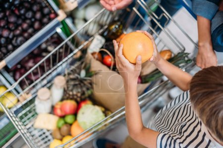 Child helping parent shopping