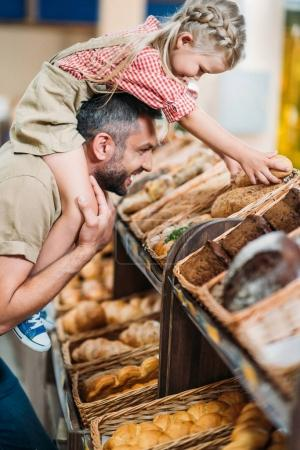 father and daughter in supermarket