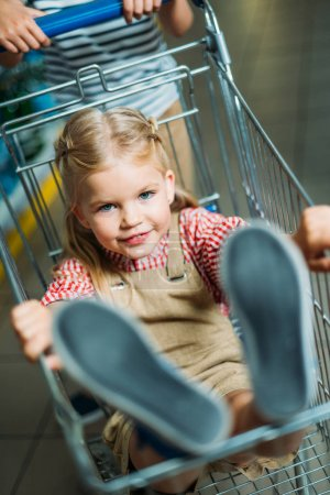 Little kid in shopping cart