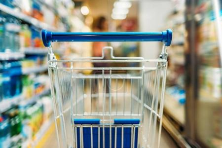 empty shopping cart in supermarket
