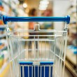 Close up view of empty shopping cart in supermarke...