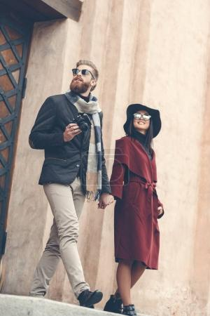 man with vintage camera and woman