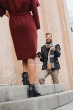 photographer talking to model