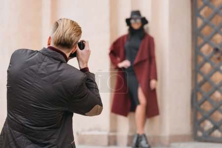 man taking photo of girlfriend