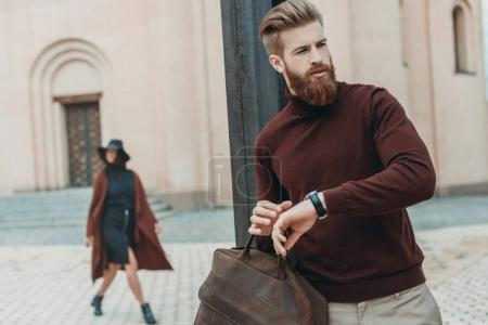 Stylish man waiting for date
