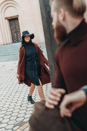 young man looking at woman