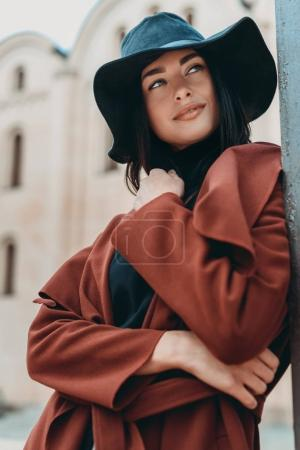 Photo for Smiling beautiful woman posing outdoors in stylish clothing - Royalty Free Image