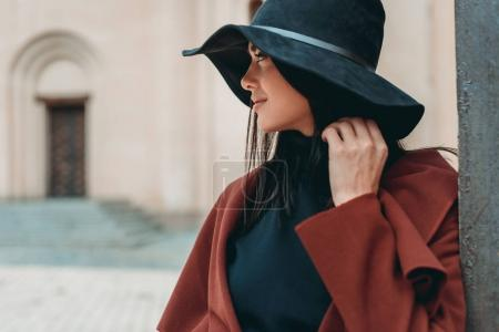 Photo for Young woman in stylish coat and hat - Royalty Free Image