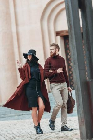 Photo for Young couple walking outdoors in old european city - Royalty Free Image