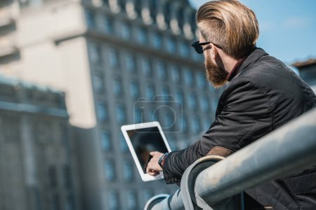 Photo for Handsome young man using tablet outdoors - Royalty Free Image