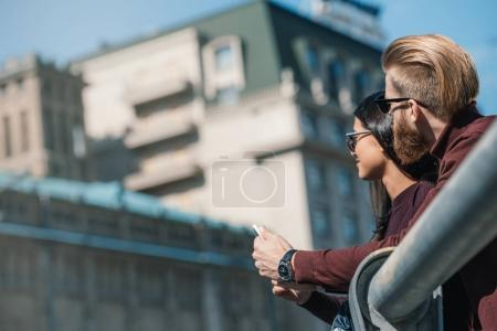 Photo for Young couple spending time together outdoors - Royalty Free Image
