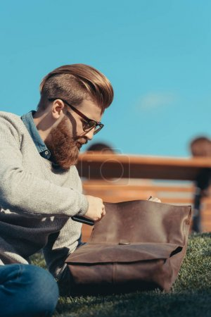young man with leather bag