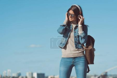 Photo for Young woman listening music with headphones outdoors on sunny day - Royalty Free Image