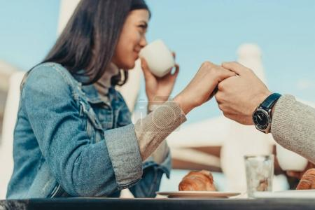 couple sitting outdoors in cafe