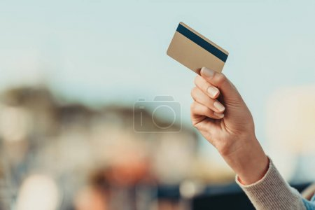 Photo for Cropped shot of woman holding credit card - Royalty Free Image