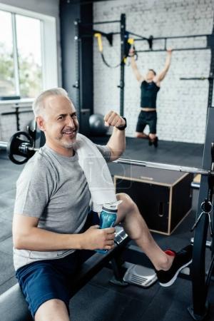 senior sportsman in gym