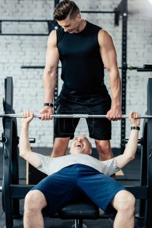 Senior sportsman lifting barbell