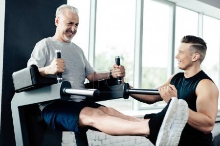 senior sportsman with trainer