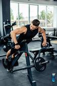 sportsman training on sport equipment