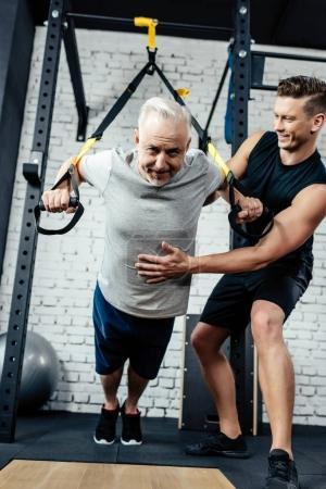 senior sportsman training with trx