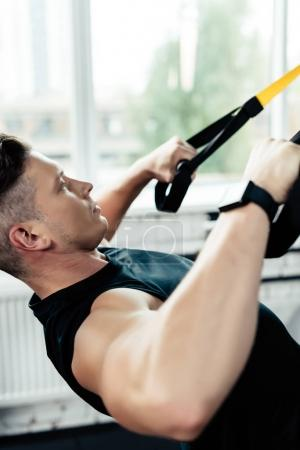 sportsman training with trx