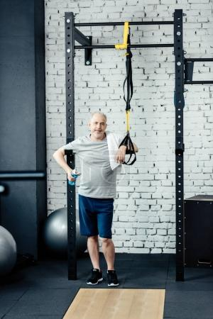 Senior sportsman with trx