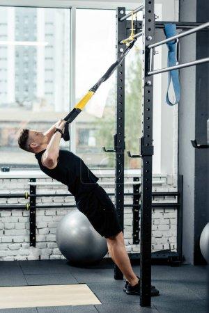 sportsman training with trx