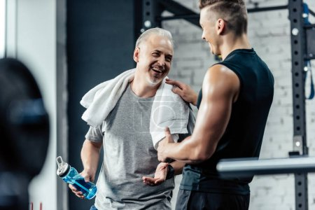 sportsman shaking hands with trainer