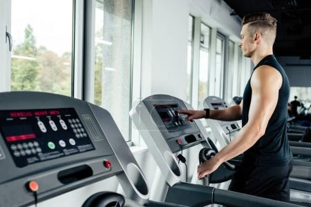 sportsman training on treadmill