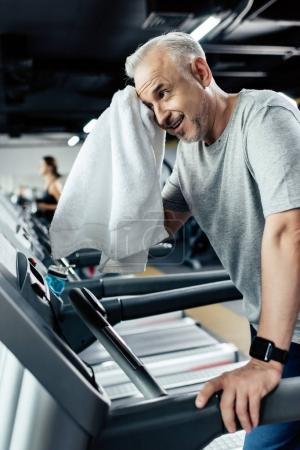 senior sportsman training on treadmill