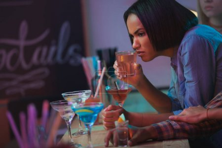 African american woman with cocktail
