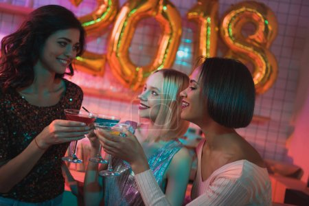 multicultural women with cocktails